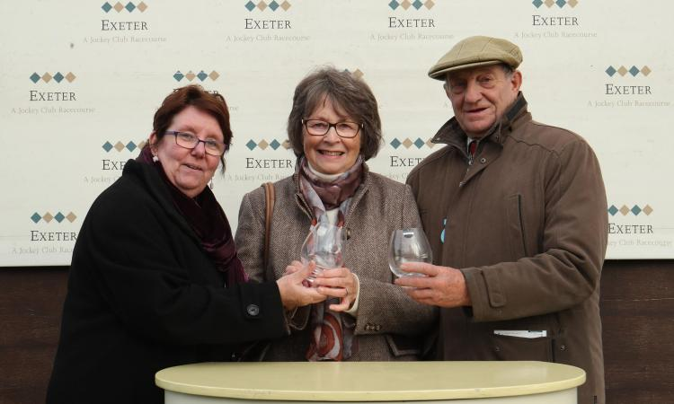Elaine Cook, CEO of  Devon Communities Together with Garth and Ann Brooks, owners of Golden Sunrise